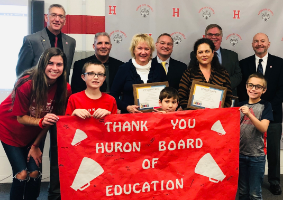 Huron Board of Education being recognized for their dedication and support for Huron City Schools