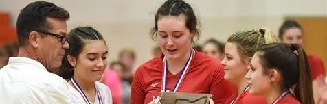 Girls holding trophy